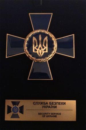 La médaille du SBU remise au Pr Masméjean.