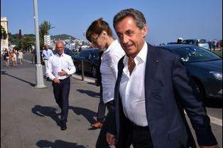 Nicolas Sarkozy et Carla Bruni. Derrière, Eric Ciotti