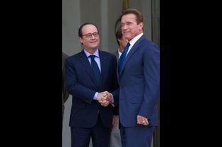 Le président François Hollande et Arnold Schwarzenegger à l'Élysée le vendredi 10 octobre 2014