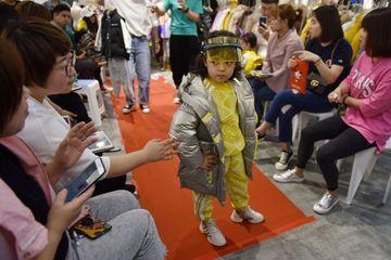 Mannequins dès 4 ans en Chine, le boom malgré la controverse