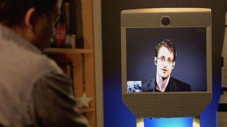 neil degrasse tyson interviews edward snowden via telepresence_credit_carlos valdes-lora-1.png
