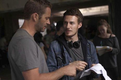 Sur le plateau de « Brick Mansions », avec Camille Delamarre, cinéaste français spécialisé dans les films d'action. A dr., à ses côtés, le comédien David Belle (en blanc). Face à lui, le rappeur RZA.