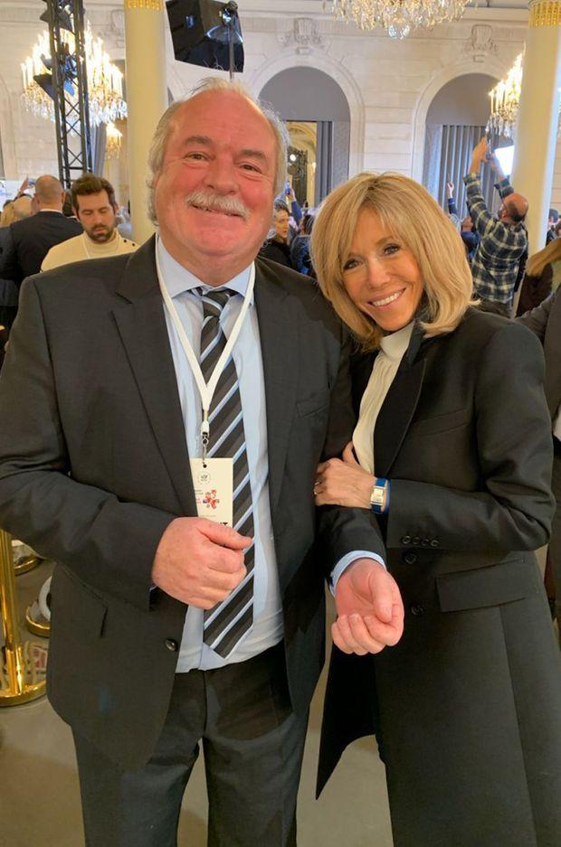 Pierre-Michel Herbelin et Brigitte Macron vendredi à l'Elysée.