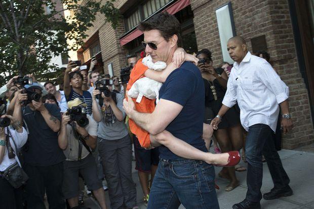 L'une des dernières apparitions de Suri dans les bras de son père, ici en 2012.