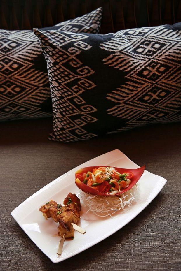 A bord, un amuse-bouche à la papaye confectionné par le chef pour ses invités.