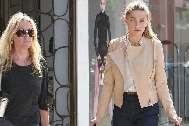 Kate Spade avec Amber Heard lors d'une virée shopping à Los Angeles en septembre 2012