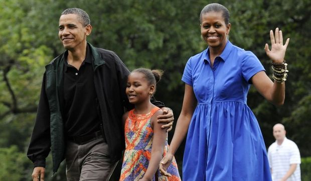 Barack Sasha et Michelle Obama-