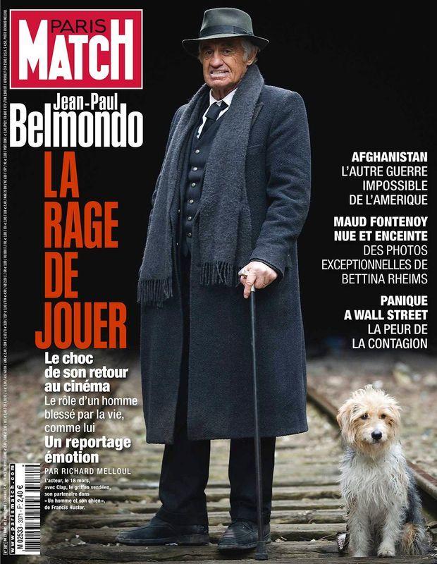 """« Une ligne de chemin de fer désaffectée à La Villette, le 18 mars 2008. La fin de tournage d'"""" Un homme et son chien """", film réalisé par Francis Huster, approche. Le chien s'appelle Clap ; l'acteur : Monsieur Belmondo. » couverture de Paris Match n° 3071, daté du 27 mars 2008."""
