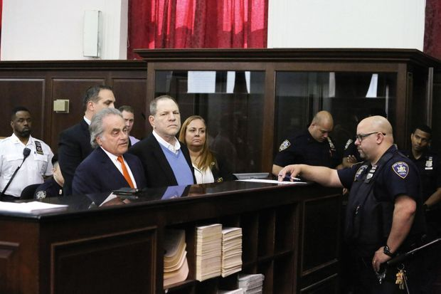 Pendant l'audience, le 25 mai à New York. Pour sa défense, le producteur a fait appel au célèbre avocat Benjamin Brafman (à g.), qui avait défendu DSK en 2011.