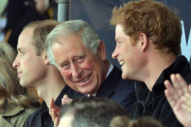 Le prince Charles avec William et Harry aux Invictus Games à Londres en septembre 2014