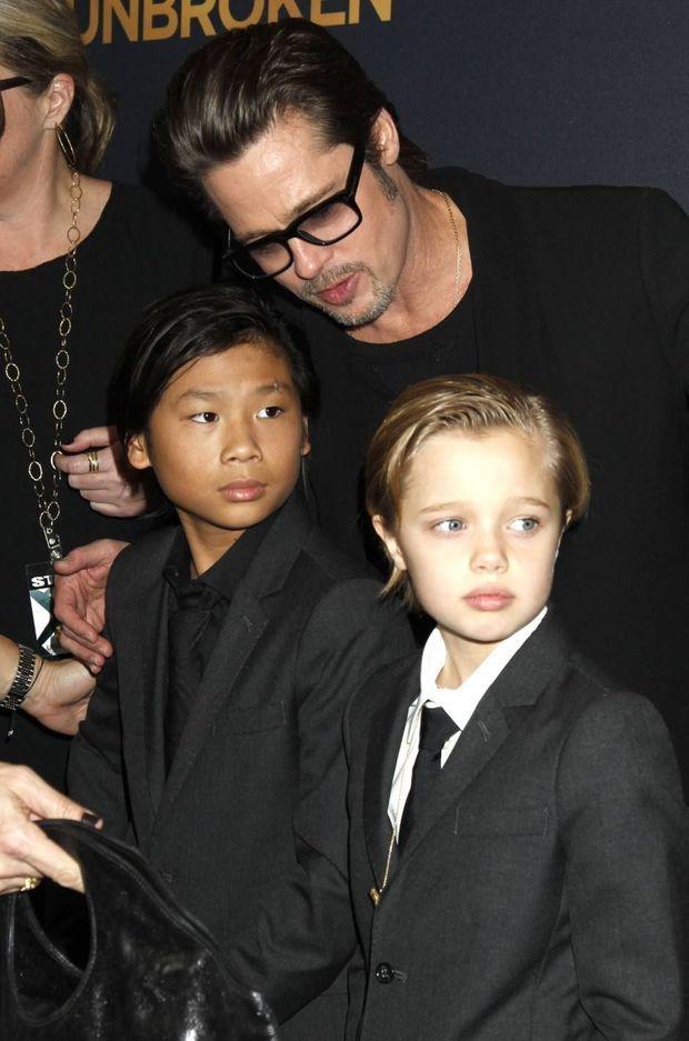 Brad Pitt avec ses enfants Pax et Shiloh en 2014