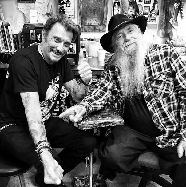 Johnny Hallyday et le tatoueur Rick Walters.