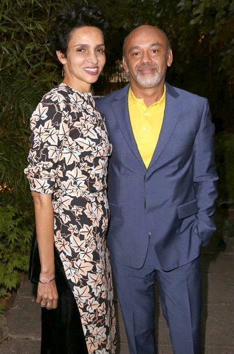 """Christian Louboutin et Farida Khelfa lors de l'avant-première du documentaire """"Des pieds à la tête"""", à Paris, le 9 septembre 2014"""