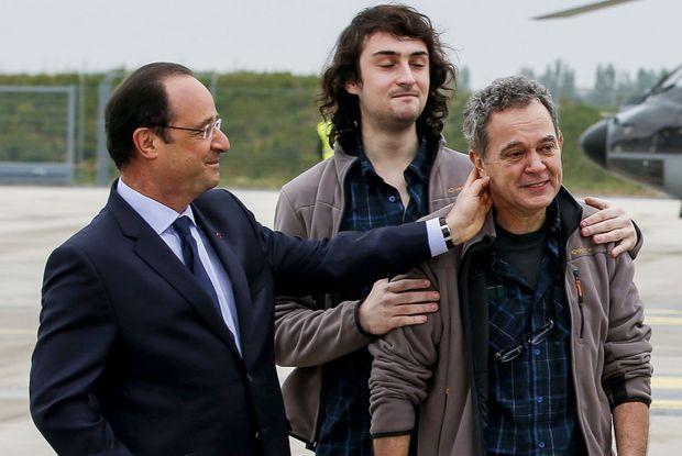 François Hollande aux côtés d'Edouard Elias et Didier François.