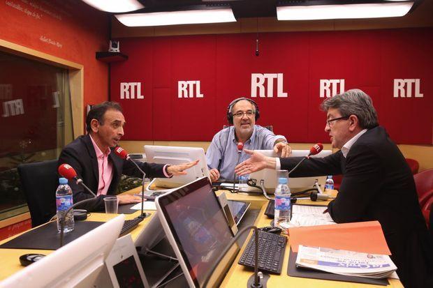 Échange musclé avec Jean-Luc Mélenchon sur le plateau de RTL, le 12 décembre 2014