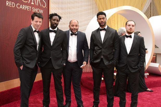 Le producteur Christophe Barral, Ladj Ly, le producteur Toufik Ayadi, Djebril Zonga et Alexis Manenti aux Oscars à Los Angeles en février 2020