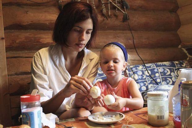 Avec Gera, sa fille, pendant les grandes vacances 2011. Cette photos a été prise par Piotr, l'époux de Nadia.
