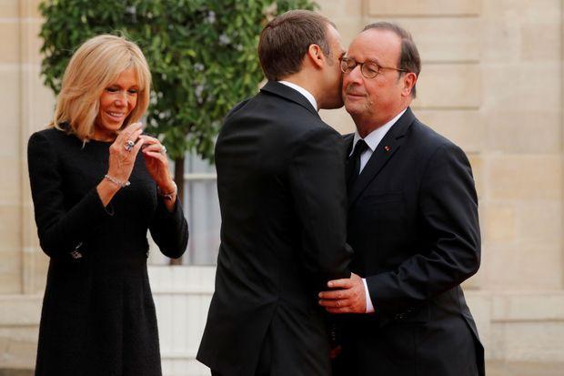 François Hollande à l'Elysée avec Emmanuel et Brigitte Macron