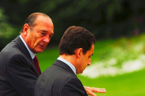 Jacques Chirac et Nicolas Sarkozy à l'Elysée, le 13 mai 2004. Le ministre de l'Economie rêve déjà de la présidence.