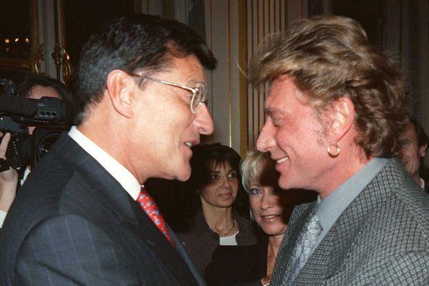 Jean-Claude Camus et Johnny Hallyday en 1997.