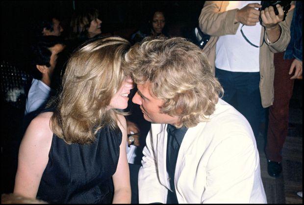 Catherine Deneuve et Johnny Hallyday, lors de la fête donnée pour les 38 ans du chanteur, le 15 juin 1981.