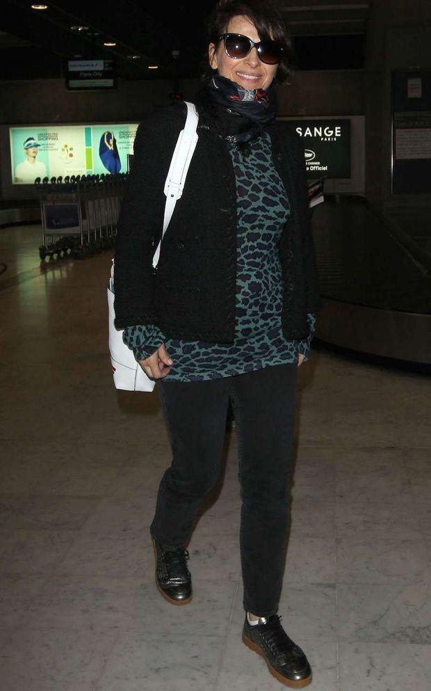 Juliette Binoche à son arrivée à l'aéroport de Cannes le 11 mai 2016.