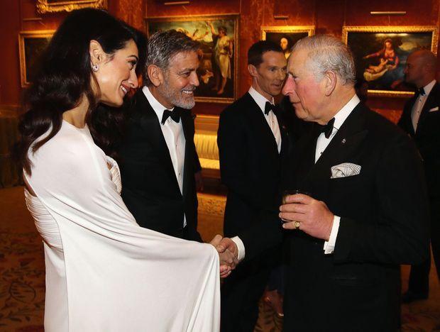 Le 12 mars 2019, à Buckingham avec le prince Charles lors d'un dîner caritatif.