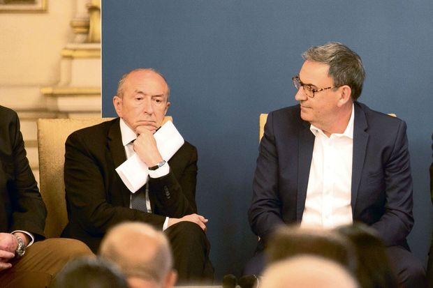 Le maire Gérard Collomb et son ex-adjoint David Kimelfeld, président de la métropole, lors d'une réunion à la préfecture de Lyon le 4 juillet.