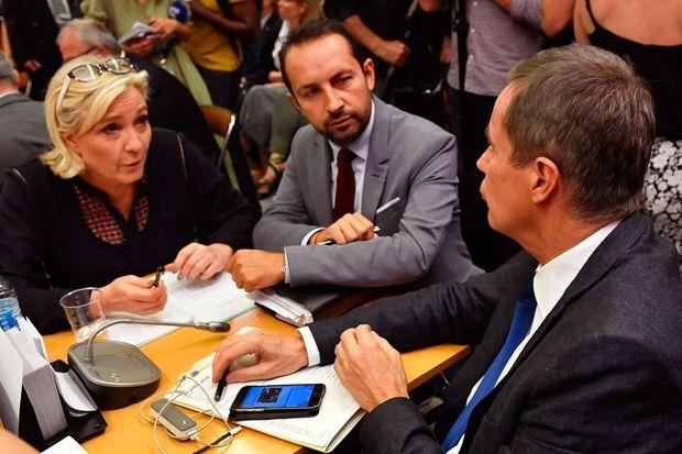 Marine Le Pen et Sébastien Chenu (RN), face à Nicolas Dupont-Aignan, lundi, lors de l'audition de Gérard Collomb à l'Assemblée nationale.
