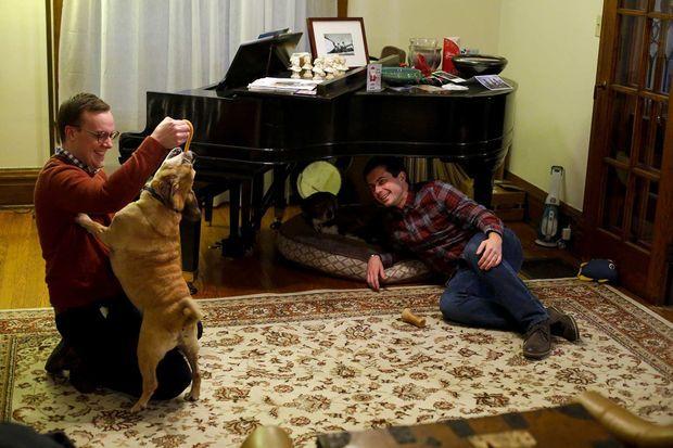 Chasten et Pete Buttigieg avec leur chien Buddy, en décembre 2018.