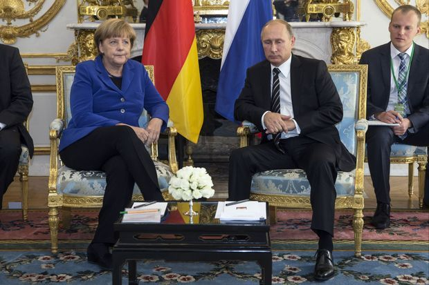 La chancelière Angela Merkel et Vladimir Poutine.