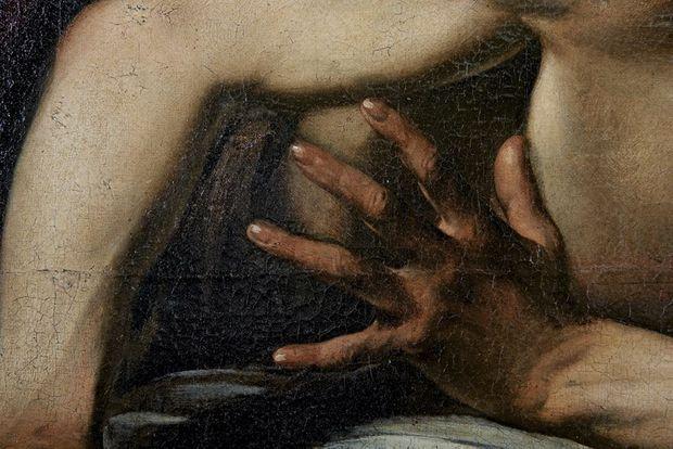 La main gauche d'Holopherne, modifiée par le peintre.