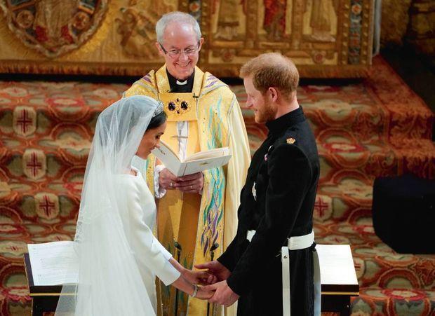 Devant l'archevêque de Canterbury, Justin Welby, le 19 mai 2018. Trois jours plus tôt, ils échangeaient déjà leurs voeux en secret.