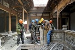 Douze ans plus tard, reconstruction près de Shanghai d'une des habitations sauvées des eaux. Désormais le pavillon culturel de l'hôtel Aman.