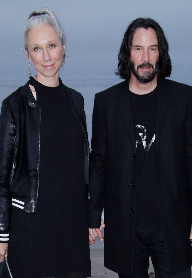 Alexandra Grant et Keanu Reeves au défilé Saint Laurent à Los Angeles en juin 2019