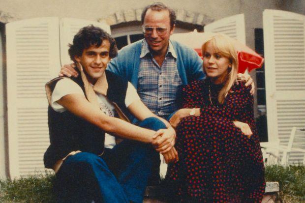 Michel Platini, Thierry Roland et sa femme.