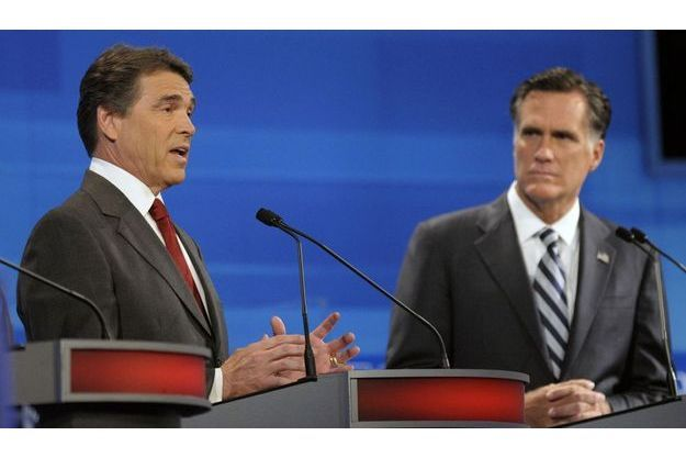 Rick Perry et Mitt Romney.
