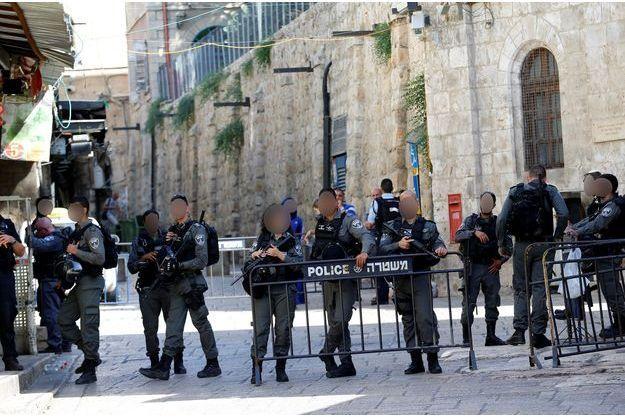Le police israélienne boucle le quartier où l'attaque s'est déroulée vendredi à Jérusalem.