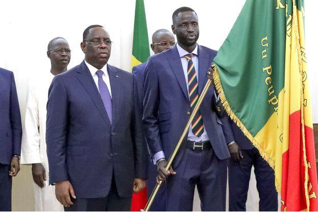 A gauche, Macky Sall, président du Sénégal.