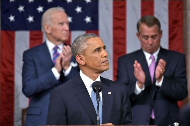 Barack Obama devant son vice-président Joe Biden et le speaker John Boehner.