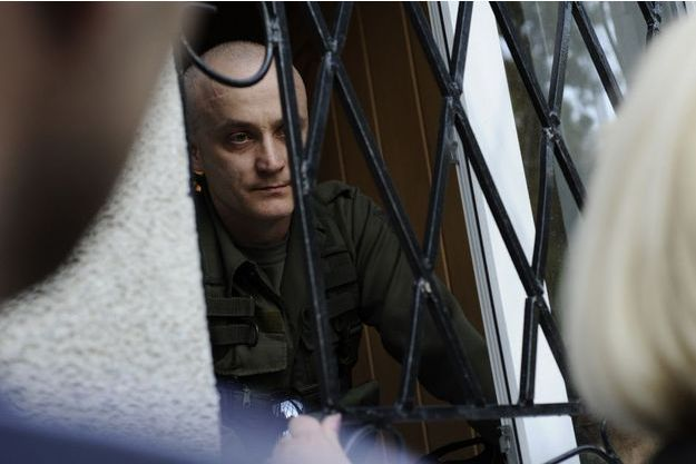 Andrey Denisenko, one of the leaders of the nationalist group Pravy Sektor, seen here entrenched in the town hall at Krasnoarmeysk on Sunday, may 11, talking to the crowd who wants to get in to take part in the referendum.
