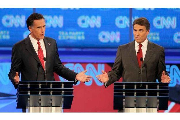 Mitt Romney et Rick Perry lors d'un précédent débat.