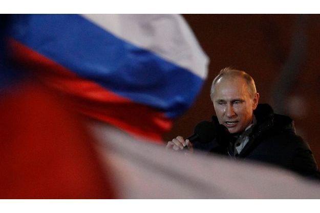 Vladimir Poutine en larmes après la proclamation de sa victoire.
