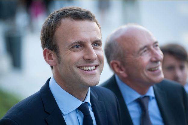 Emmanuel Macron à Lyon avec le maire de la ville Gerard Collomb (à droite), samedi 24 septembre.