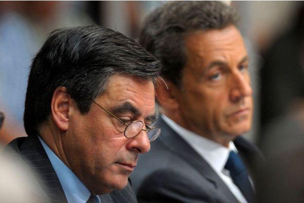 François Fillon et Nicolas Sarkozy côte-à-côte en juin 2011.