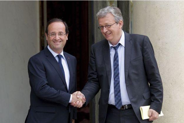 Le président de la République et Pierre Laurent, secrétaire national du PCF.