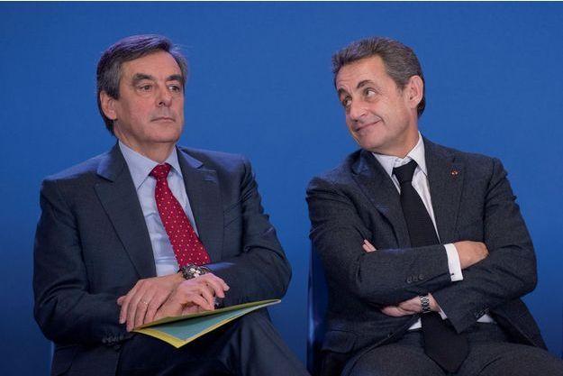 François Fillon et Nicolas Sarkozy, le 18 mars 2015.