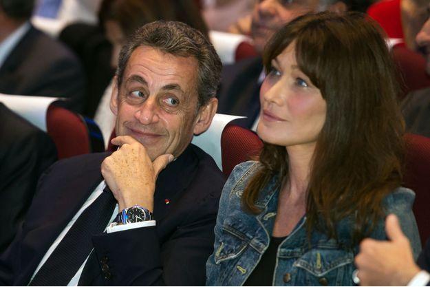 Nicolas Sarkozy et Carla Bruni, lors d'un meeting en octobre 2016.