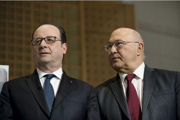 François Hollande et Michel Sapin, qui «pilote» le service de renseignement financier de Bercy.