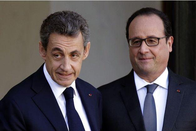 Nicolas Sarkozy et François Hollande à l'Elysée le 15 novembre.